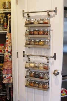 If you want to gain valuable storage space in any (!) room in your home, just look on the other side of your door. Here, a spice rack takes advantage of a pantry door and makes it way easier to find things when in a rush.