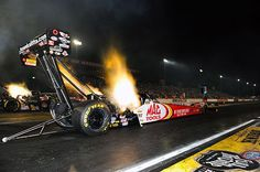 Great flames-up image of the new Mac Tools dragster driven by Doug Kalitta in Friday qualifying at the 2012 Mac Tools U.S. Nationals in Indy!
