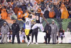 CINCINNATI, OH - JANUARY 09:  A.J. Green #18 of the Cincinnati Benglas reaches up to catch a pass against the Pittsburgh Steelers at Paul Brown Stadium on January 9, 2016 in Cincinnati, Ohio.  (Photo by Andy Lyons/Getty Images)