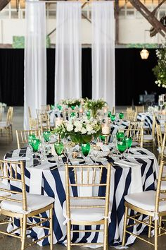 Low centerpieces on striped tablecloths | @lauren_fair | Brides.com