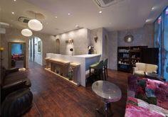 Barstools at reception counter. INITY hair salon by Hajime Yoshimoto of VOIGER, Osaka store design by tanya