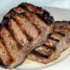 """Italian Spiced Pork Chops """"I love the recipe, and so does my husband. He's not apt to say much about food, but he ate the pork chops and commented saying: 'That was really good. Tender Pork Chops, Grilled Pork Chops, Baked Pork Chops, Grilled Meat, Pork Rib Recipes, Grilling Recipes, Meat Recipes, Dinner Recipes, Grilling Ideas"""