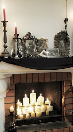 Welcome to Allerdale Hall. Candle lit fireplace décor and vintage photo display, inspired by the Gothic mansion in Crimson Peak.