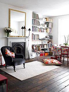 Clean bookshelves. That luscious charcoal/black chair.
