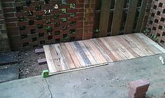 Expanding+patio+with+repurposed+pallets