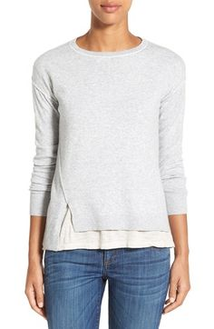 Free shipping and returns on Caslon® Relaxed Long Sleeve Sweater (Regular & Petite) at Nordstrom.com. Reverse-seam detailing brightened with contrast color puts a fresh spin on a classic crewneck sweater spun from a soft cotton blend. Notches vent the front hem, and dainty pointelle stitching traces the center back.