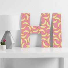 Lisa Argyropoulos Gone Bananas In Pink Decorative Letters | DENY Designs Home Accessories #alphabet #letters #cute #fun #bananas #home #decor #gifts #holiday #DENYholiday #shopsmall #CyberMonday #awesome