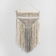 Dress up your wall in artisan style with our cozy woven wall hanging, crafted by hand in India.