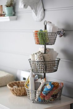 Use a tiered kitchen basket in the kids' bathroom as the perfect spot to stash washcloths, burp cloths and lotions. Clever!