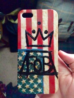 """A friend gave me one of her old phone cases that had an American flag on it!  When I saw it I came up with the idea to paint the Fall Out Boy logo on it!  It turned out great!  I love my """"new"""" phone case!!"""