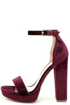 "A proper party deserves the Demi Wine Velvet Platform Heels! Strut your stuff in these sexy velvet heels with a peep-toe upper, 1"" toe platform and adjustable ankle strap with gold buckle."