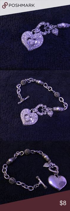 Charm bracelet Beautiful heart charm bracelet ! Has that Victorian touch to it that I just love ! Worn a lot but still in good condition. All stones are intact the just the silver beads and back of heart have noticeable wear to it . Please see pics ! Jewelry Bracelets