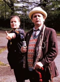 The Seventh Doctor and Ace. Trying to thumb a lift!