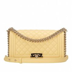 8fb048cac131 Chanel yellow lambskin Medium Boy bag with light gold tone hardware in  store fresh condition. Shop authentic pristine Chanel Boy bags at Madison  Avenue ...