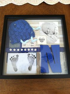 Baby's Shadow box - The fabric and buttons came from his newborn outfit, the ribbon/paper from gifts for him, the hat was a handmade gift and the pins holding the hat in place came from my wedding bouquet. Everything in it has some meaning. <3