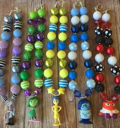 Hand strung INSIDE OUT necklaces that feature Pixar's adorable characters. Matching bracelets are also available. Buy them at PinkBubbleGumBling