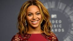 In this Aug. 24, 2014 file photo, Beyonce backstage at the MTV Video Music Awards in Inglewood, Calif. Beyonce is competing against, Sam Smith, Beck, Ed Shee...