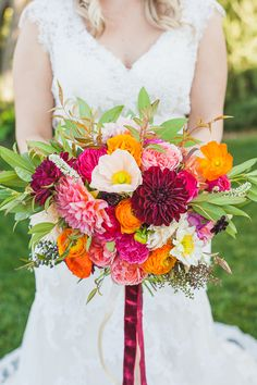 orange pink and red bouquet by Thistle and Honey