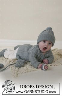 BabyDROPS 14-2 - DROPS jacket in round yoke and cables, hat with pompons, mittens, socks and blanket in Alpaca and rattle in Muskat or Safran. - Free pattern by DROPS Design