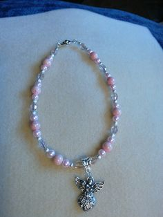 Angel car mirror charm, made with pink creamed stones, trimmed with pink pearl and ab pink glass oblong beads, trimmed with silver spacers.