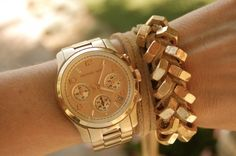 Love the gold bracelets.