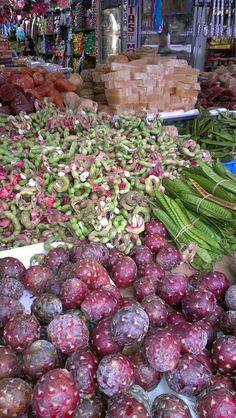 Burgundy colors Tijuana Market. Guamuchiles, guajes y pitayas, también dulce de calabaza y biznaga