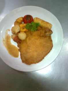 Chicken maryland with corn and banana fritters, potato croquette, bacon and grilled tomatoes