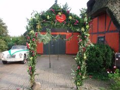 A Danish wedding tradition; family and friends of the marrying couple create a 'doorway' from greenery and flowers, which the married couple must pass through for good luck :-)