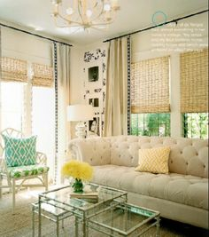 living rooms - white faux bamboo chair green cushion silver faux bamboo nesting tables turquoise pillow silver gourd lamp ivory beige cotton drapes black ribbon border trim sisal rug bamboo roman shades soft sand beige walls