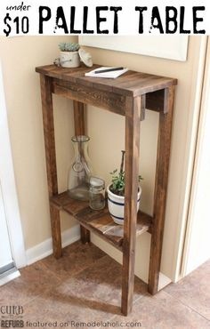 Build a simple console table or end table for under $10 using old pallet wood. Link fixed to point to original blogger.