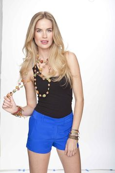 Alice Callahan looks gorgeous wearing a Support Haiti Necklace and Many Hopes Bracelets while rocking Amanda Uprichard Blue Silk Shorts (Available in Petite and Medium) and a Recover Tank (Available in Multiple Sizes & Colors)