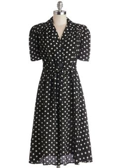 If Vintage is your style ... check this one out.  According to Lesson Plan Dress - off-white polka dots and oversized buttons are parts of this black shirt dress     #ModCloth