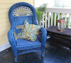 Love the bright blue wicker for the front porch