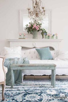 How to decorate for summer with blue and green in a coastal style living room from ShabbyFufu Blog.