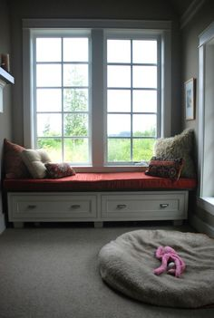 Window seat, at the end of the sewing/laundry room? Width of twin bed?