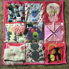 This quilt has sold but is an example if you would like to order a cat themed Quilt with pockets for weights on the back. This one of a kind handmade quilt has many items to help soothe anxious hands and nervousness in people with Alzheimers Disease, stroke, dementia or Autisim. This quilt is approximately 25 square. It is backed with soft fleece and zippered pockets for adding weight.  This is the first Quilt I have made with pockets on the back. You would need to add double bagged and…