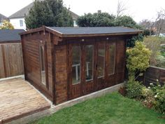 """Garden workshop complete with custom built workbench, six double brushed steel sockets and switch, spot lights, laminate flooring and plenty of storage. Garden Cabins, Man Shed, Garden Workshops, Outside Room, Sunken Garden, Building Companies, Garden Office, Garden Buildings, Dog Houses"