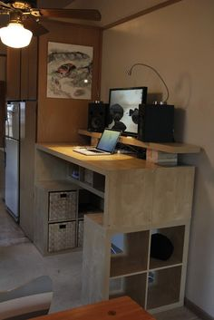 Standing hieght computer station for the kitchen is an interesting idea - desk made from IKEA shelving