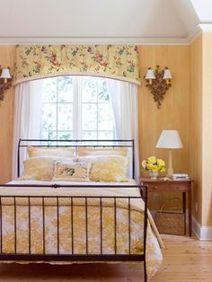 Sunshine + Ivory  Color and paint create character in a small space, such as this charming bedroom. Sunny yellow walls are painted to mimic wide wooden boards, while yellow and ivory toile linens, a yellow chintz valance, golden sconces, and the bold contrast of an iron bed combine to produce a look that's simple yet sophisticated.