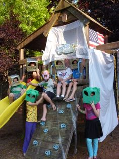 Space birthday with alien masks and astronaut masks made out of boxes
