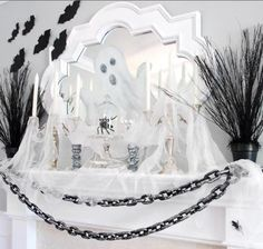 Love the cheesecloth draped over inexpensive Halloween decor to add spookiness