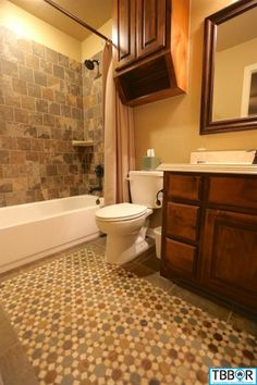 tile in bathrooms (mosaic and basket weave designs) framed out mirrors, neat tile floor design