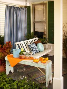Curtains and a swing on a front porch