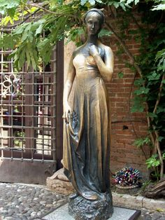 Juliet's statue, Verona, Italy. Thousands have written and left letters for Juliet, wishing for luck in love.