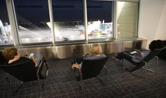 Travelers at the new Dwight D. Eisenhower National Airport relax in rocking chairs looking out over the airports gate area. (June 3, 2015)