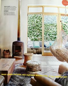 Leafy outlooks from each room in the house, wood burning stove, hanging chair, authentic surfaces :: Real Living Magazine