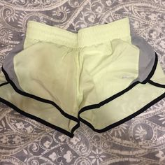 Nike running shorts Dri-fit In wonderful condition! Worn a handful of times. I removed the draw string but the elastic around the waist does enough as far as keeping the shorts up! Nike Shorts