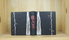 Design binding-Silver river The book is full leather binding with inlay and onlay decoration on the cover. Edge to edge doublure of leather and handmade marbling endpapers.