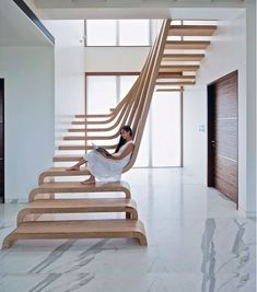 modern wooden stair design ideas  full guide to choose, design and install a perfect modern staircase design, expert tips for stair handrails, spiral staircase designs, LED stair lights and collection of other contemporary staircase design ideas