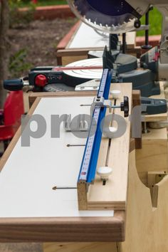 Side View Detail of Fence Assembly on Folding Wing on Rolling Chop Saw Stand with Bosch 12